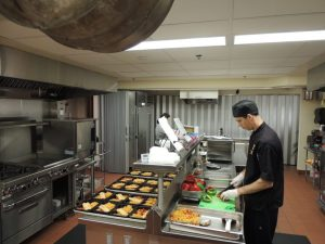Chef Williams preparing meals in kitchen